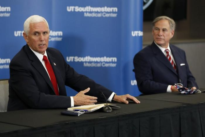 Vice President Mike Pence makes remarks as Texas Gov. Greg Abbott looks on during a news conference after Pence met with Abbott and members of his healthcare team regarding COVID-19 at the University of Texas Southwestern Medical Center West Campus in Dallas, Sunday, June 28, 2020