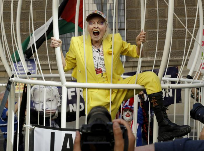 Fashion designer Vivienne Westwood stands in a giant bird cage in protest against the extradition of WikiLeaks founder Julian Assange to the U.S.