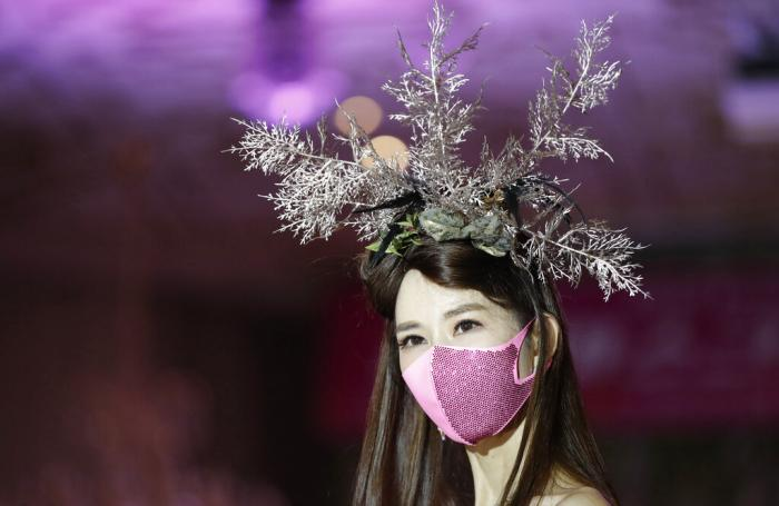 A model wearing a face mask takes part in a mask fashion show in Seoul, South Korea.