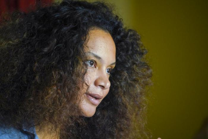 Fashion designer Stella Jean talks during an interview with the Associated Press, in Rome.