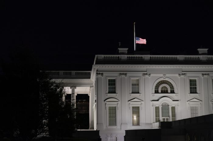 The flag at the White House flies at half-staff Friday, Sept. 18, 2020, in Washington, after the Supreme Court announced that Supreme Court Justice Ruth Bader Ginsburg has died of metastatic pancreatic cancer at age 87. (AP Photo/Alex Brandon)