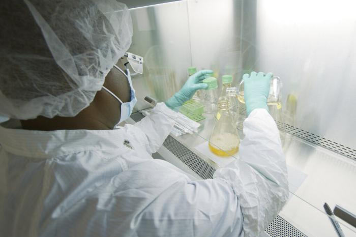 A researcher tests possible COVID-19 antibodies in a laboratory in Indianapolis.