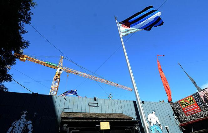 The leather pride flag flies at the Eagle bar in 2018 as construction continues on a mixed-use development that will pay for a leather-themed public plaza nearby