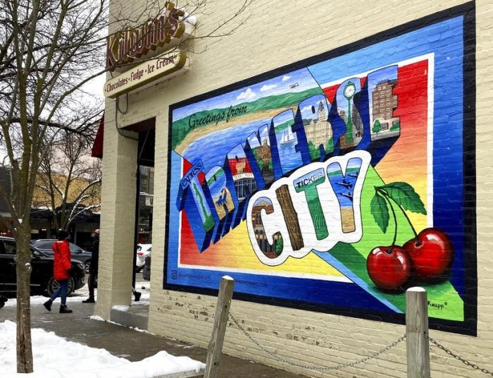 A mural adorns the wall of a chocolate shop in downtown Traverse City, Mich.