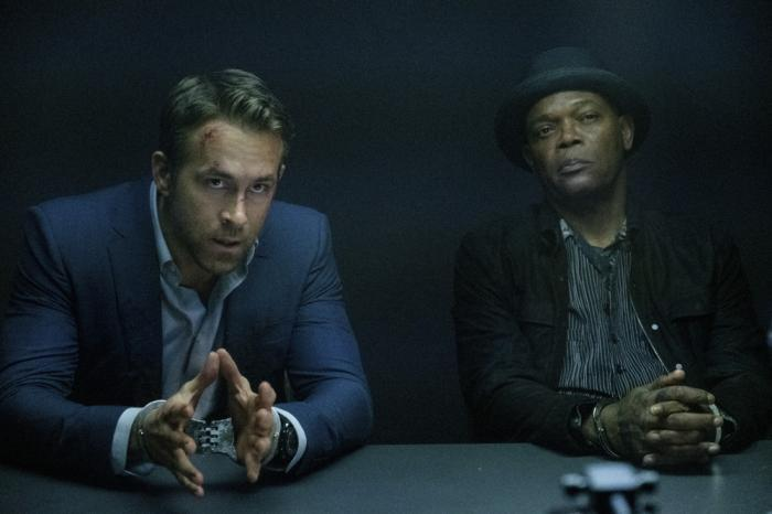 """This image released by Lionsgate shows Ryan Reynolds, left, and Samuel L. Jackson in a scene from """"The Hitman's Wife's Bodyguard."""""""