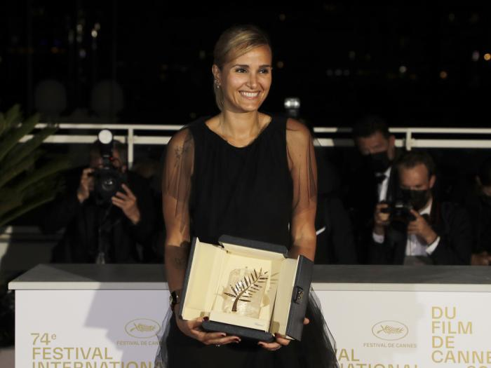 Director Julia Ducournau, winner of the Palme d'Or for the film 'Titane' poses for photographers during a photo call following the awards ceremony at the 74th international film festival, Cannes, southern France, Saturday, July 17, 2021