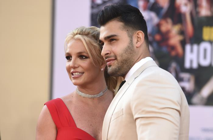 """Britney Spears and Sam Asghari arrive at the Los Angeles premiere of """"Once Upon a Time in Hollywood,"""" at the TCL Chinese Theatre."""